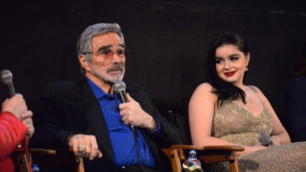 """HOLLYWOOD, CA - MARCH 22:  Actors Burt Reynolds and Ariel Winter address the audience during a Q&A session at the Los Angeles premiere of """"The Last Movie Star"""" at the Egyptian Theatre on March 22, 2018 in Hollywood, California.  (Photo by Michael Tullberg/Getty Images)"""