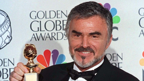 "Burt Reynolds holds his Golden Globe award won for best supporting actor in a motion picture for ""Boogie Nights"" at the 55th annual Goden Globe Awards in Beverly Hills, January 18. The awards, sponsored by the Hollywood Foreign Press Association, honor excellence in film and television.  GOLDEN GLOBES - RTRALQK"