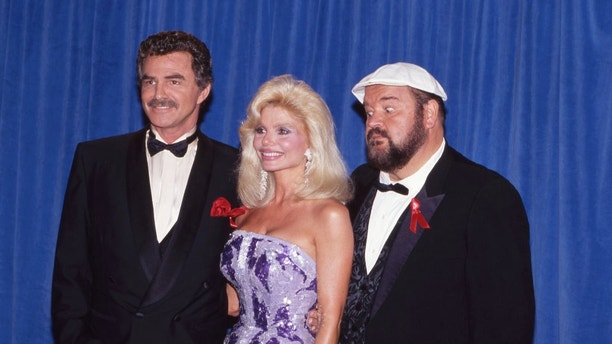 PASADENA, CA - AUGUST 25: Burt Reynolds, Loni Anderson and Dom DeLuise at The 43rd Primetime Emmy Awards on August 25, 1991 at Pasadena Civic Auditorium in Pasadena, California. (Photo by Craig Sjodin/ABC via Getty Images)