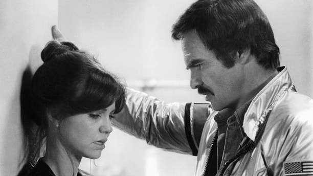 Sally Field talks while Burt Reynolds listens in a scene from the film 'Hooper', 1978. (Photo by Warner Brothers/Getty Images)
