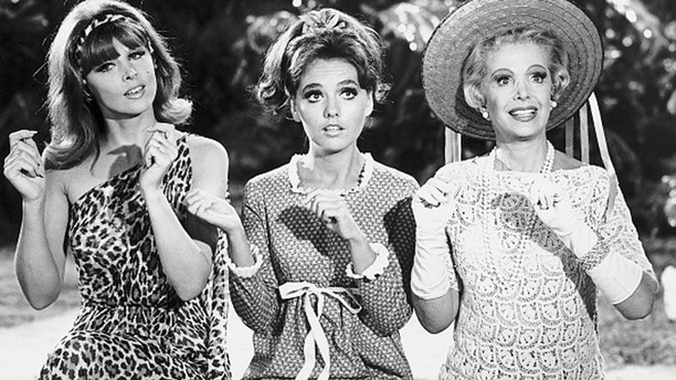 """From left to right, sex-kitten Ginger (Tina Louise), girl-next-door Mary Ann (Dawn Wells), and millionairess Mrs. Howell (Natalie Schaefer) in a scene from the 1960s television comedy """"Gilligan's Island."""""""