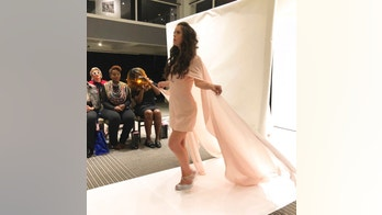 Model Marian Avila wears an outfit from the Talisha White 2019 spring collection on the runway during Fashion Week, Saturday, Sept. 8, 2018, in New York. Avila, a 21-year-old Spanish model with Down syndrome, fulfilled her dream to walk at New York Fashion Week thanks to White, the Atlanta designer she met through the magic of social media. (AP Photo/Leanne Italie)