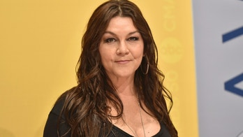 """FILE - In this Nov. 2, 2016 file photo, Gretchen Wilson arrives at the 50th annual CMA Awards at the Bridgestone Arena in Nashville, Tenn. Wilson has agreed to donate $500 to charity to settle a criminal charge related to a disturbance at a Connecticut airport last month. The Grammy-winning """"Redneck Woman"""" singer appeared Thursday, Sept. 13, 2018  in court in Enfield. A misdemeanor breach of peace charge will be dismissed based on the donation to a fund for injured crime victims.  (Photo by Evan Agostini/Invision/AP, File)"""