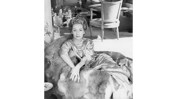 Mrs. Leonard (Felicia) Bernstein wearing gold tea jacket and pearls, seated in her home. (Photo byHenry Clarke/Condé Nast via Getty Images)