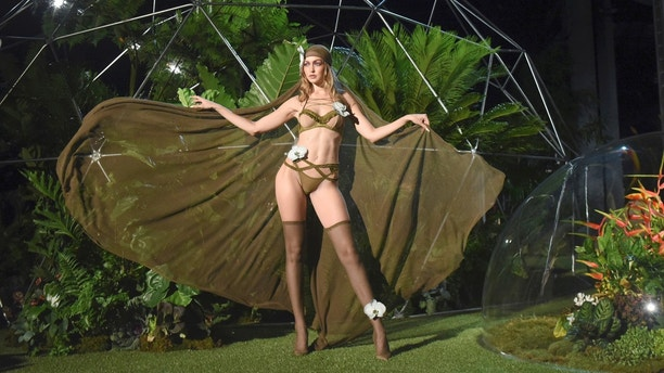 Gigi Hadid models a Savage X Fenty look before a performance at the Brooklyn Navy Yard at the end of Fashion Week, Wednesday Sept. 12, 2018, in the Brooklyn borough of New York. Rihanna unleashed the wild beast in a lush tropical land to debut her second season of Savage x Fenty lingerie and loungewear. (AP Photo/Diane Bondareff)