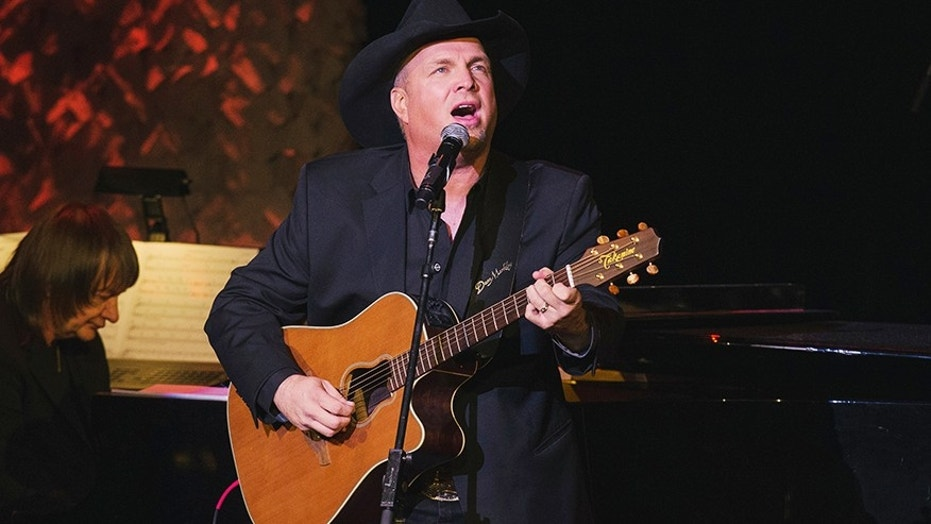 """Garth Brooks says he may take up Simon Cowell's suggestion to help one of the """"American's Got Talent"""" hopefuls to write some music."""