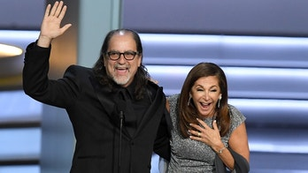 LOS ANGELES, CA - SEPTEMBER 17:  Glenn Weiss  (L), winner of the Outstanding Directing for a Variety Special award for 'The Oscars,' and Jan Svendsen react after getting engaged onstage during the 70th Emmy Awards at Microsoft Theater on September 17, 2018 in Los Angeles, California.  (Photo by Kevin Winter/Getty Images)