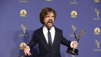 """IMAGE DISTRIBUTED FOR THE TELEVISION ACADEMY - Peter Dinklage poses in the press room with the award for outstanding supporting actor in a drama series for """"Game of Thrones"""" at the 70th Primetime Emmy Awards on Monday, Sept. 17, 2018, at the Microsoft Theater in Los Angeles. (Photo by Willy Sanjuan/Invision for the Television Academy/AP Images)"""