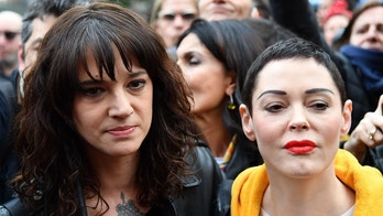 Italian actress Asia Argento (L) and US singer and actress Rose McGowan, who both accuse Harvey Weinstein of sexual assault, take part in a march organised by 'Non Una Di Meno' (Me too) movement on March 8, 2018 as part of the International Women's Day in Rome.  'Non Una Di Meno', which translates as Not One (Woman) Less, is the equivalent of the movement that grew out of the Harvey Weinstein-spurred sexual harassment and rape revelations.  / AFP PHOTO / Alberto PIZZOLI        (Photo credit should read ALBERTO PIZZOLI/AFP/Getty Images)