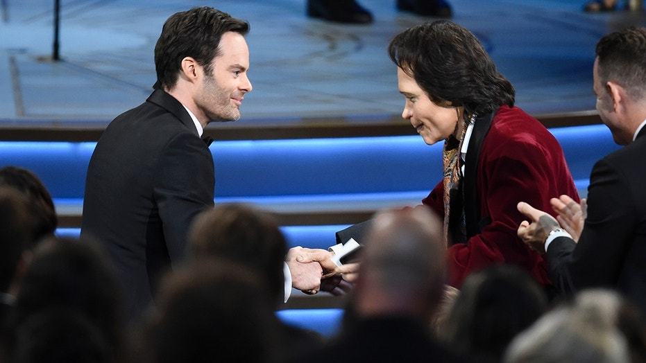 "Teddy Perkins, right, congratulates Bill Hader as he gets ready to walk on stage to accept the award for outstanding lead actor in a comedy series for ""Barry"" at the 70th Primetime Emmy Awards."