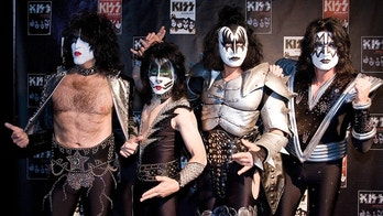 """Paul Stanley, Eric Singer, Gene Simmons and Tommy Thayer (L-R) of the U.S. rock group KISS pose for photographers at the Koenig-Pilsener-Arena in Oberhausen, May 8, 2008. KISS will perform their first concert in Germany in ten years """"KISS/alive35"""" at the Arena in Oberhausen on Friday.   REUTERS/Kirsten Neumann  (GERMANY) - BM2E45816BL01"""