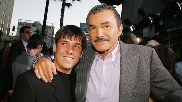 """LOS ANGELES - MAY 19:  Actor Burt Reynolds and his son Quinton arrive at the premiere of Paramount Pictures' """"The Longest Yard"""" at the Chinese Theater on May 19, 2005 in Los Angeles, California.  (Photo by Kevin Winter/Getty Images)"""