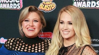 HOLLYWOOD, CA - JUNE 22:  Kelly Clarkson (L) and Carrie Underwood attend the 2018 Radio Disney Music Awards at Loews Hollywood Hotel on June 22, 2018 in Hollywood, California.  (Photo by Rich Fury/Getty Images)