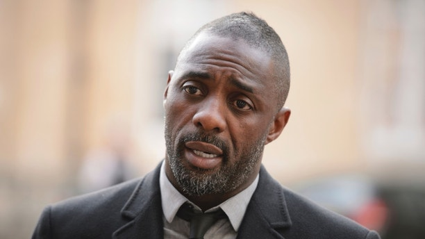 """British actor Idris Elba speaks to the media ahead of the """"Defeating Ebola: Sierra Leone"""" conference in central London, on October 2, 2014. REUTERS/POOL/Leon Neal"""