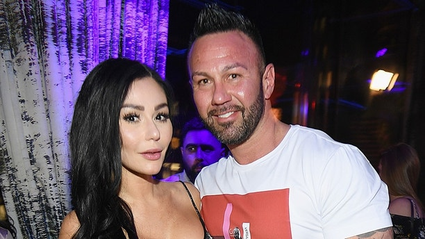 """NEW YORK, NY - APRIL 04:  Television personality Jenni 'JWoww' Farley (L) and Roger Mathews attend MTV's """"Jersey Shore Family Vacation"""" New York premiere party at PHD at the Dream Downtown on April 4, 2018 in New York City.  (Photo by Dave Kotinsky/Getty Images for MTV)"""