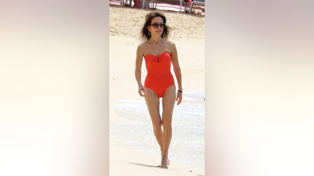 EXCLUSIVE: Susan Lucci shows off her remarkable figure in a red swimsuit at the beach in Barbados. 13 Feb 2018 Pictured: Susan Lucci. Photo credit: QueensoftheNorth/MEGA TheMegaAgency.com +1 888 505 6342 (Mega Agency TagID: MEGA163683_001.jpg) [Photo via Mega Agency]
