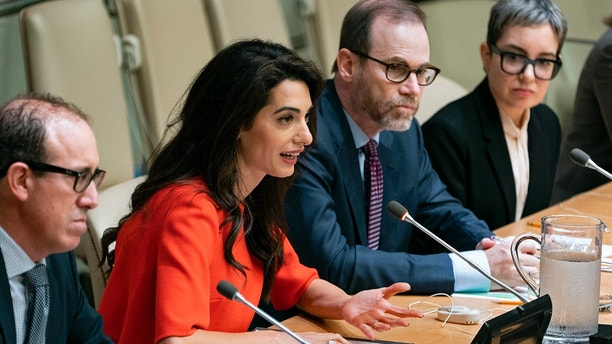 """International human rights lawyer Amal Clooney answers a question during a conference called """"Press Behind Bars: Undermining Justice and Democracy,"""" at the 73rd session of the United Nations General Assembly, at U.N. headquarters, Friday, Sept. 28, 2018. Left is Joel Simon, Executive Director of the Committee to Protect Journalists, and right center is Steven J. Adler, President and Editor-in-Chief of Reuters. (AP Photo/Craig Ruttle)"""