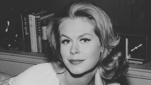 """Actress Elizabeth Montgomery is shown on the set of the television show """"Bewitched,"""" in which she plays the role of Samantha, in 1964.  (AP Photo)"""