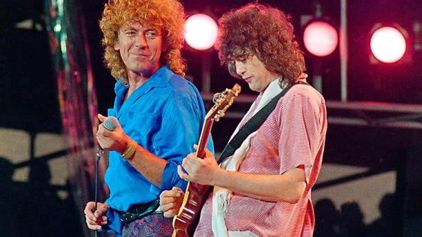 """FILE - In this July 13, 1985 file photo, Led Zeppelin bandmates, singer Robert Plant, left, and guitarist Jimmy Page, reunite to perform for the Live Aid famine relief concert at JFK Stadium in Philadelphia. A U.S. appeals court on Friday, Sept. 28, 2018, ordered a new trial in a lawsuit accusing Led Zeppelin of copying an obscure 1960s instrumental for the intro to its classic 1971 rock anthem """"Stairway to Heaven.""""   (AP Photo/Amy Sancetta, File)"""