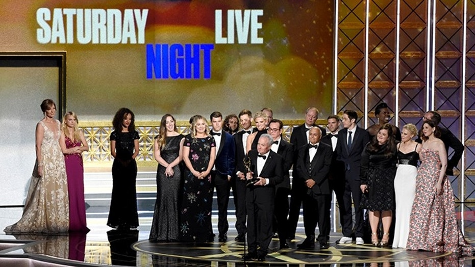 """Producer Lorne Michaels and the cast of """"Saturday Night Live"""" appear at the 69th Primetime Emmy Awards in Los Angeles, Sept. 17, 2017."""