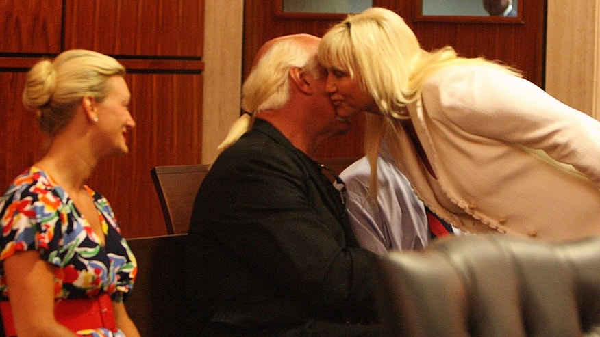 Jennifer McDaniel, left, girlfriend of Hulk Hogan, also known as Terry Bollea, looks on as he kisses Linda Bollea, Tuesday, July 28, 2009 at a divorce settlement hearing between Hogan and his wife Linda Bollea in Clearwater, Fla. (AP Photo/St. Petersburg Times, Scott Keeler) ** TAMPA OUT, USA TODAY OUT, HERNANDO TODAY OUT, CITRUS COUNTY CHRONICLE OUT, MAGS OUT, NO SALES **