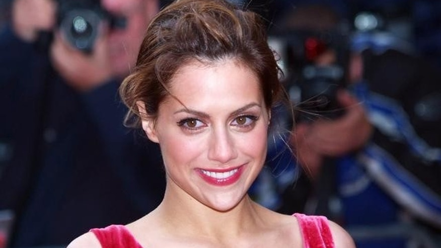 "U.S. actress Brittany Murphy arrives for the UK Premiere of her latest film, ""Sin City"", in London's Leicester Square, Monday May 23, 2005. (AP Photo/ Max Nash)"