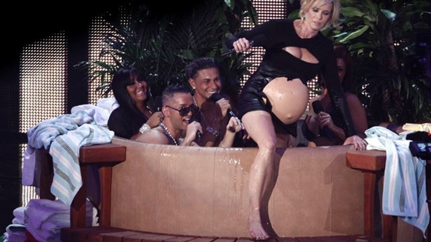 Host Chelsea Handler is seen during a skit with the cast of Jersey Shore at the MTV Video Music Awards on Sunday, Sept. 12, 2010. (AP Photo/Matt Sayles)