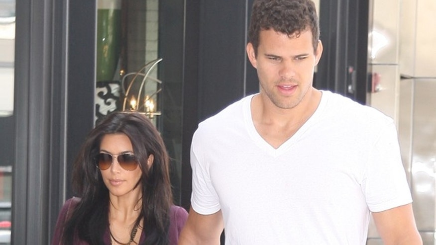 Kim Kardashian and fiance Kris Humphries at Nate N' Al Delicatessen in Beverly Hills.  June 14, 2011 X17online.com