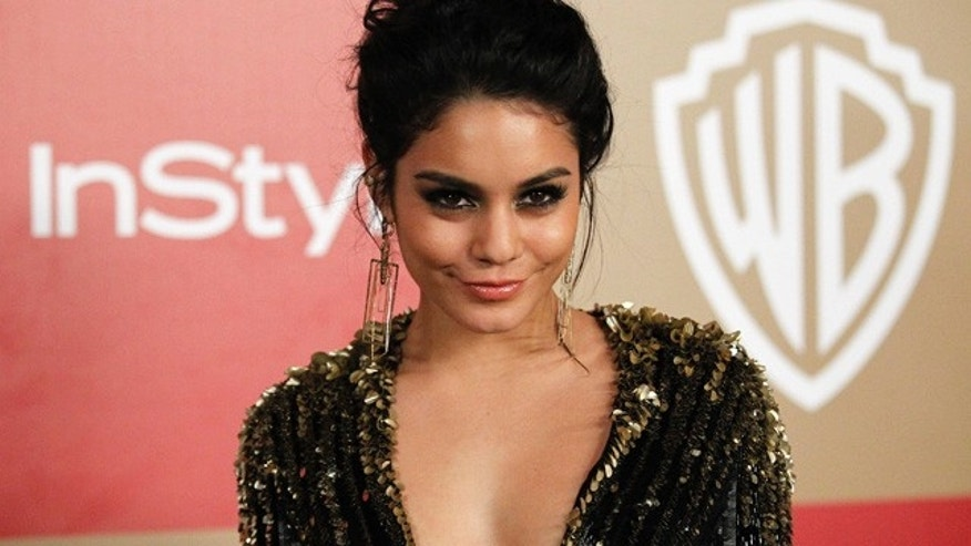 Actress Vanessa Hudgens poses at the InStyle/Warner Bros. after party following the 70th annual Golden Globe Awards in Beverly Hills, California January 13, 2013. REUTERS/Mario Anzuoni  (UNITED STATES - Tags: ENTERTAINMENT) (GOLDENGLOBES-PARTIES) - RTR3CFKA