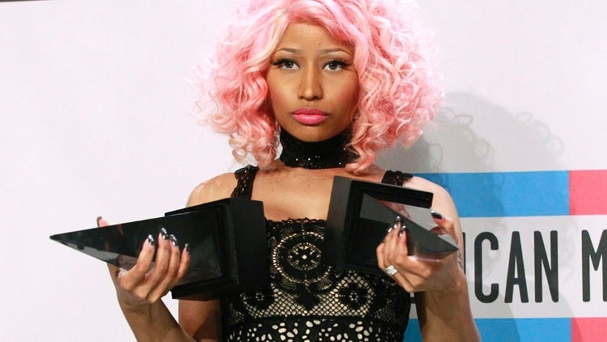 Singer Nicki Minaj poses with her awards for Favorite Rap/Hip Hop Artist and Favorite Rap/Hip Hop album