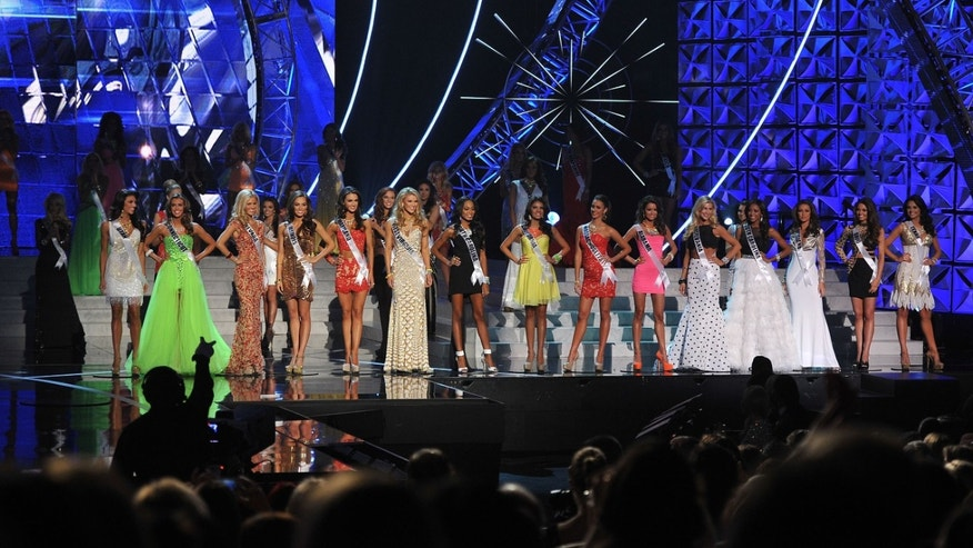 The top fifteen Miss USA finalists pose onstage during the Miss USA 2013 pageant, Sunday, June 16, 2013, in Las Vegas. (AP Photo/Jeff Bottari)