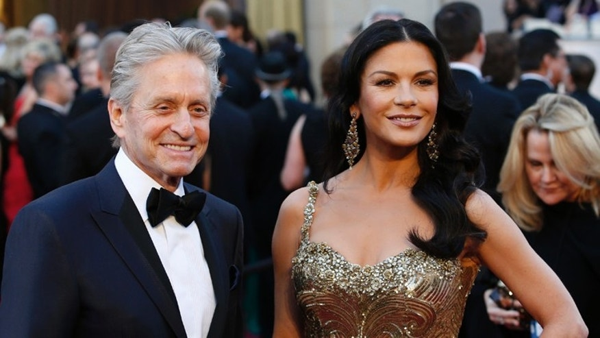 Catherine Zeta Jones and Michael Douglas arrive at the 85th Academy Awards in Hollywood, California February 24, 2013.  REUTERS/Adrees Latif  (UNITED STATES TAGS:ENTERTAINMENT) (OSCARS-ARRIVALS) - RTR3E8L2