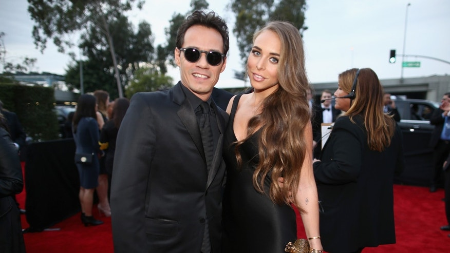 LOS ANGELES, CA - JANUARY 26: Singer Marc Anthony (L) and TV personality Chloe Green attend the 56th GRAMMY Awards at Staples Center on January 26, 2014 in Los Angeles, California.  (Photo by Christopher Polk/Getty Images for NARAS)