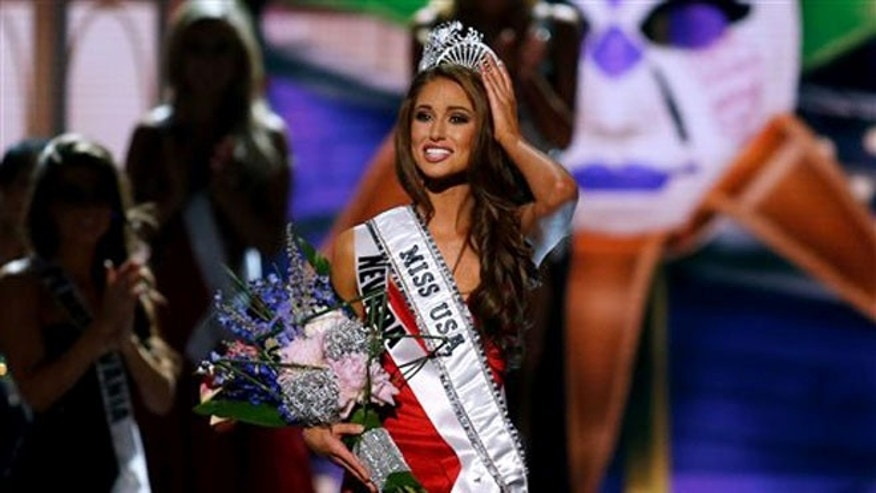 Miss Nevada USA Nia Sanchez adjusts her crown after  being crowned the new Miss USA during the Miss USA 2014 pageant in Baton Rouge, La., Sunday, June 8, 2014. (AP Photo/Jonathan Bachman)