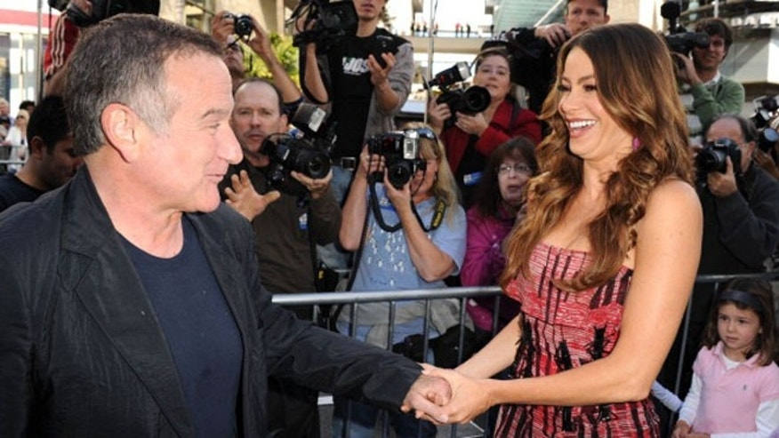"HOLLYWOOD, CA - NOVEMBER 13:  Actors Robin Williams (L) and Sofia Vergara attends the Premiere of Warner Bros. Pictures' ""Happy Feet Two"" at Grauman's Chinese Theatre on November 13, 2011 in Hollywood, California.  (Photo by Kevin Winter/Getty Images)"