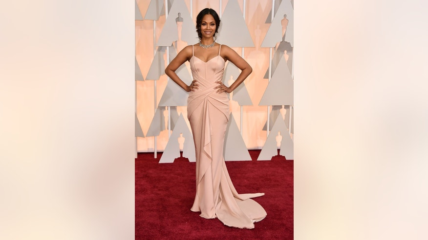 Zoe Saldana arrives at the Oscars on Sunday, Feb. 22, 2015, at the Dolby Theatre in Los Angeles. (Photo by Jordan Strauss/Invision/AP)