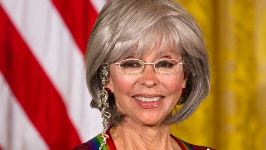 2015 Kennedy Center Honors honoree actress and singer Rita Moreno attends the 2015 Kennedy Center Honors reception in the East Room of the White House in Washington, Sunday, Dec. 6, 2015. (AP Photo/Jacquelyn Martin)