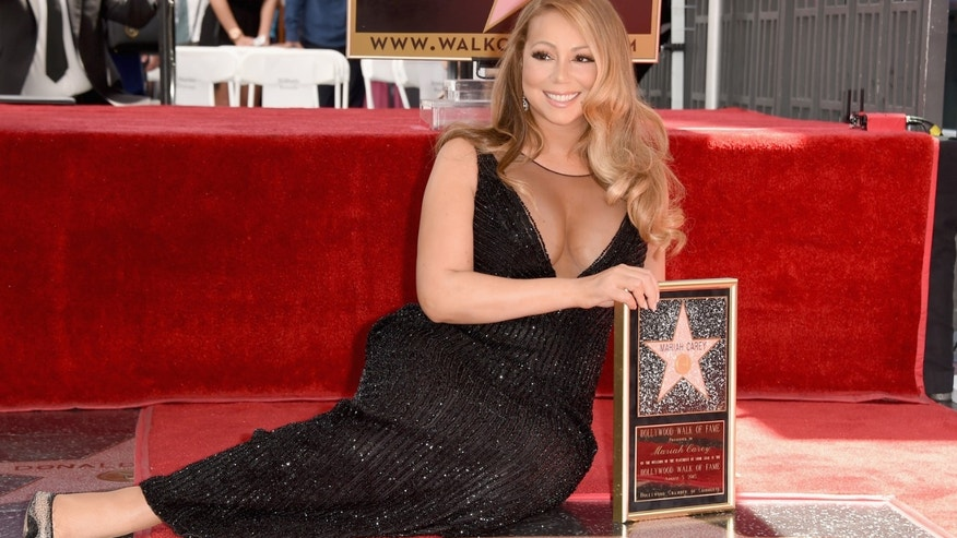 HOLLYWOOD, CA - AUGUST 05:  Singer Mariah Carey is honored with Star on The Hollywood Walk of Fame on August 5, 2015 in Hollywood, California.  (Photo by Kevin Winter/Getty Images)
