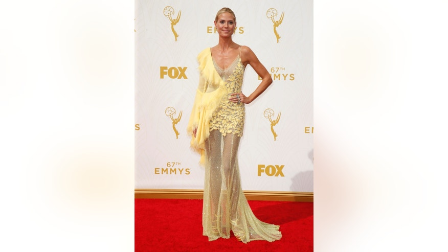 IMAGE DISTRIBUTED FOR THE TELEVISION ACADEMY - Heidi Klum arrives at the 67th Primetime Emmy Awards on Sunday, Sept. 20, 2015, at the Microsoft Theater in Los Angeles. (Photo by Danny Moloshok/Invision for the Television Academy/AP Images)