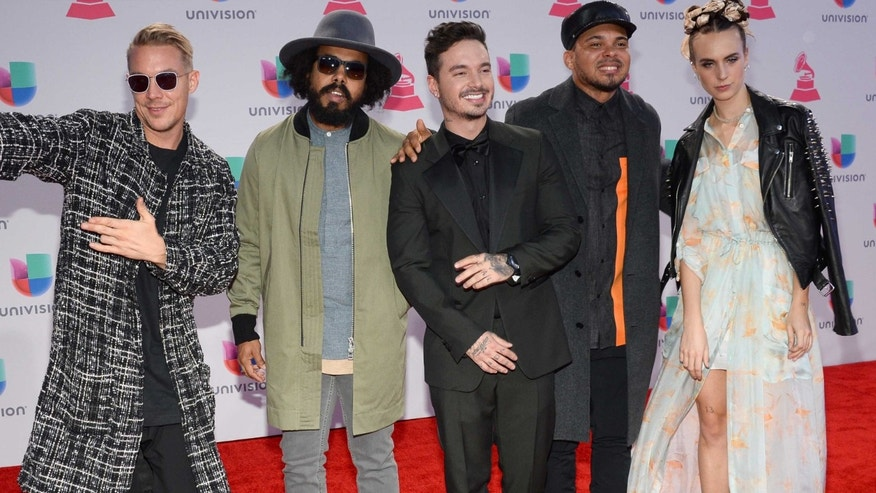 J Balvin, center, Mo, right, and from left, Diplo, Jillionaire and Walshy Fire, of Major Lazer, arrive at the 16th annual Latin Grammy Awards at the MGM Grand Garden Arena on Thursday, Nov. 19, 2015, in Las Vegas. (Photo by Al Powers/Invision/AP)