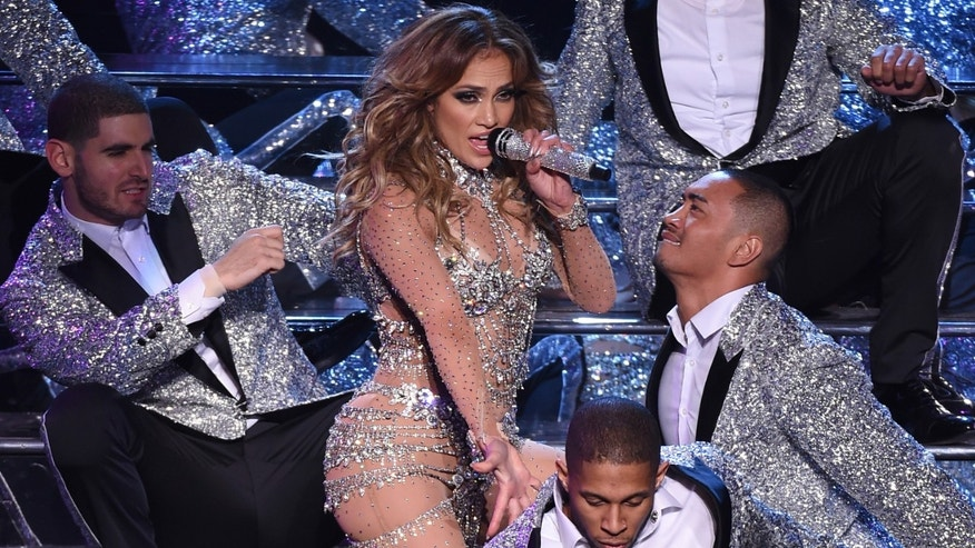 "LAS VEGAS, NV - JANUARY 20:  Singer/actress Jennifer Lopez (C) performs with dancers during the launch of her residency ""JENNIFER LOPEZ: ALL I HAVE"" at The Axis at Planet Hollywood Resort & Casino on January 20, 2016 in  Las Vegas, Nevada.  (Photo by Ethan Miller/Getty Images)"