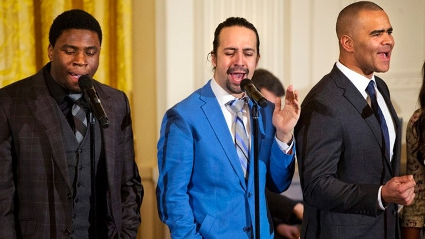 "Actor Okieriete Onaodowan, left, actor Lin-Manuel Miranda, and actor Christopher Jackson perform the song ""Alexander Hamilton"" from the Broadway play ""Hamilton"" in the East Room of the White House, in Washington, Monday, March 14, 2016. (AP Photo/Jacquelyn Martin)"