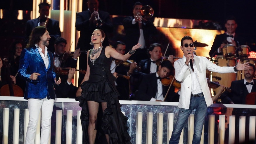 Singers Marco Antonio Solis, left, Natalia Jimenez and Marc Anthony, right, perform during the Latin Billboard Awards, Thursday, April 28, 2016 in Coral Gables, Fla. (AP Photo/Wilfredo Lee)