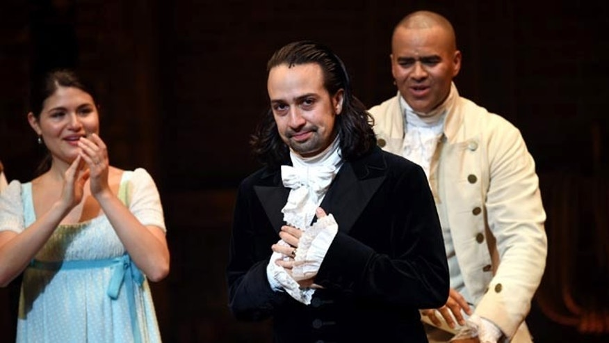 "Actor and ""Hamilton"" creator Lin-Manuel Miranda, center, takes his final performance curtain call at the Richard Rogers Theatre on Saturday, July 9, 2016, in New York. (Photo by Evan Agostini/Invision/AP)"
