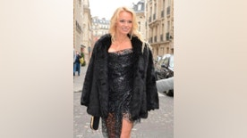 Pamela Anderson shows off her legs upon arriving at the Top Model Belgium competition, held in Paris. Anderson serves as President of the jury. December 18, 2016 X17online.com USA ONLY