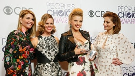 """Actresses Lori Laughlin, Andrea Barber, Jodie Sweetin and Candace Cameron Bure (from L) pose backstage with their award for Favorite Premium Comedy Series for """"Fuller House"""" at the People's Choice Awards 2017 in Los Angeles, California, U.S., January 18, 2017.  REUTERS/Danny Moloshok - RTSW6NP"""