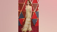 Emma Stone arrives at the Oscars on Sunday, Feb. 26, 2017, at the Dolby Theatre in Los Angeles. (Photo by Richard Shotwell/Invision/AP)