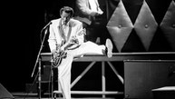 """Chuck Berry performs during a concert celebration for his 60th birthday at the Fox Theatre in St. Louis, Mo., Oct. 17, 1986.  The concert is being filmed for a motion picture documentary titled """"Chuck Berry Hail! Hail! Rock 'n' Roll.""""  (AP Photo/James A. Finley)"""