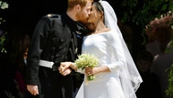 Prince Harry and Meghan Markle kiss on the steps of St George's Chapel in Windsor Castle after their wedding.  Saturday May 19, 2018.  Ben Birchall/Pool via REUTERS - RC1CC954DD40