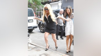 Jessica Simpson slips on the sidewalk with her high heel shoes in New York City